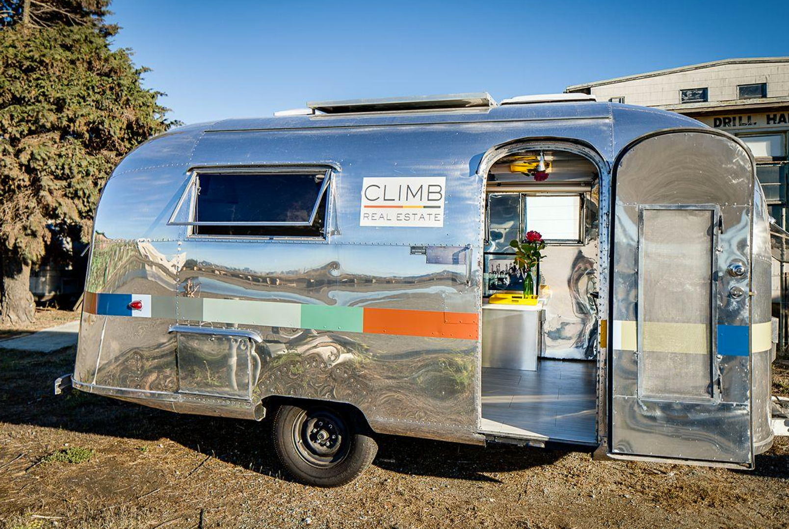 silver Airstream trailer sign by CLIMB Real Estate
