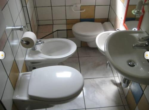 Bathroom with toilets and sinks