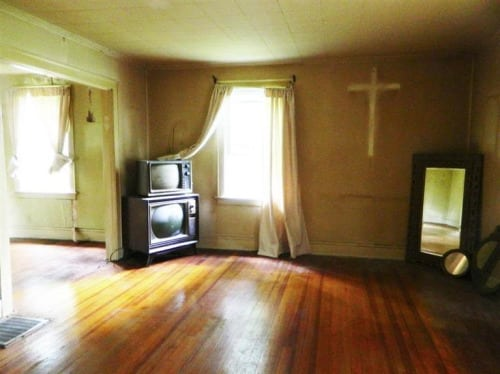 bad real estate photos: Room with huge cross