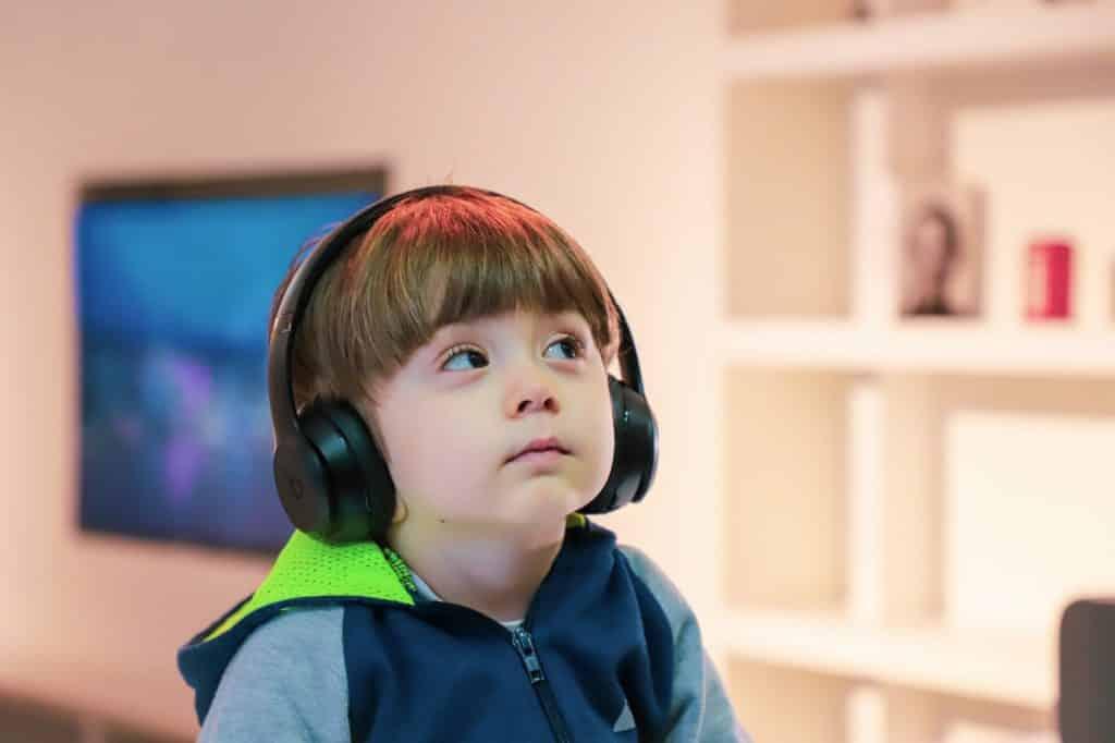 Child Listening on Headphones