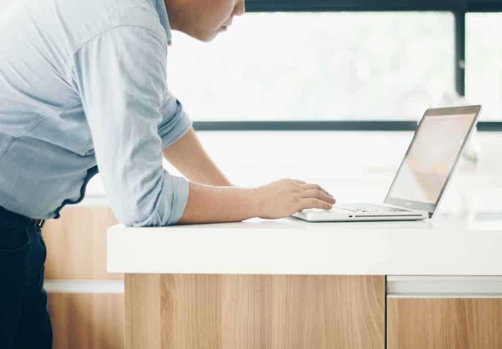 Man Browsing on Laptop