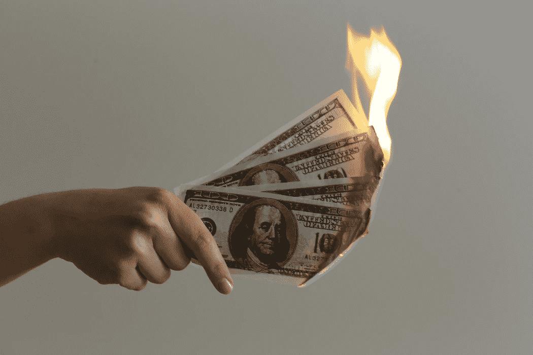 burning dollar bills