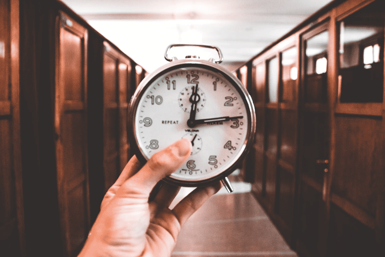 Holding a Clock at the Hallway