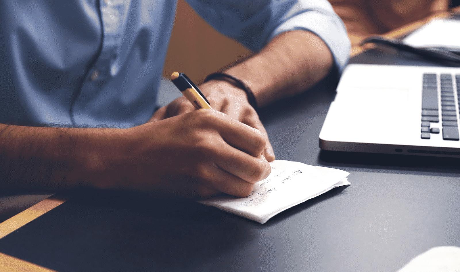 Man Writing Exam Day