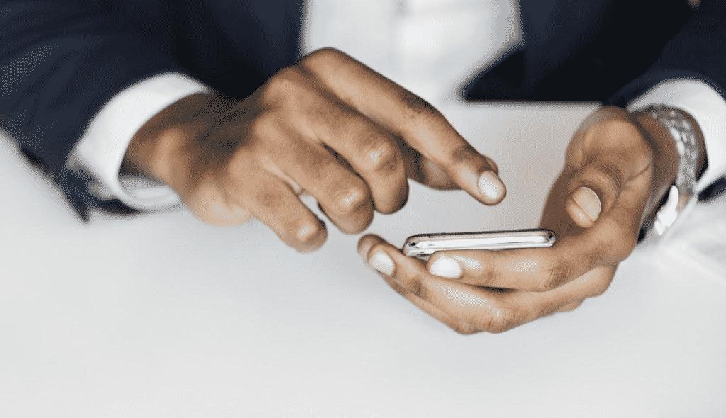 man hands using mobile phone