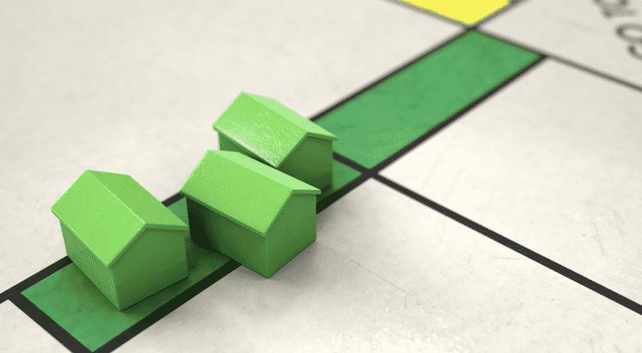 three green miniature house models