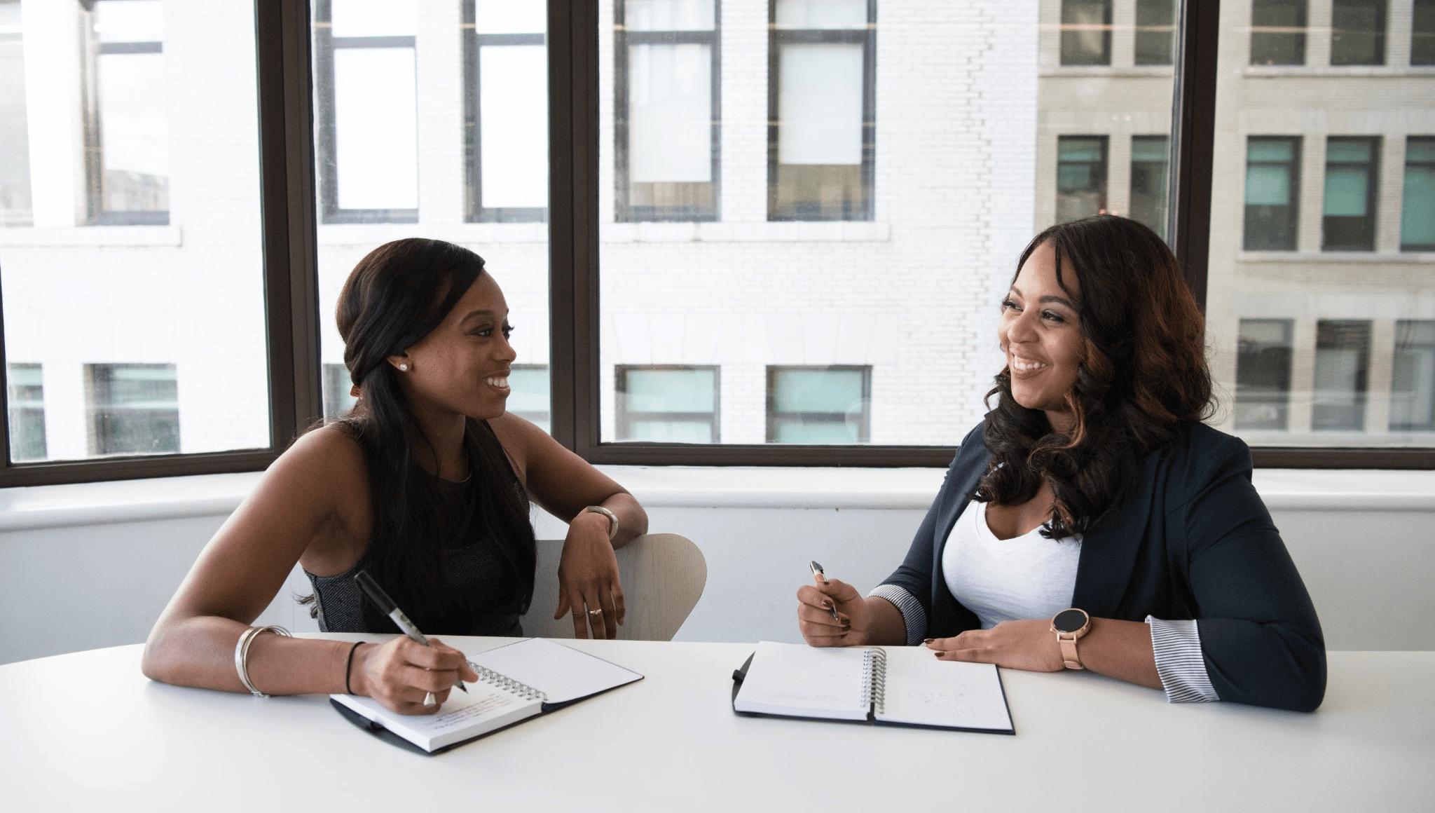 two women having fun discussion